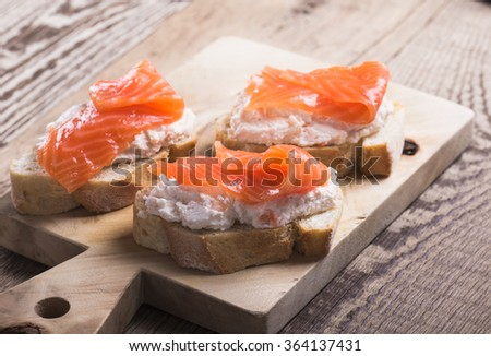 Homemade toasts with smoked salmon cream cheese dip. Best smoked salmon appetizers - stock photo