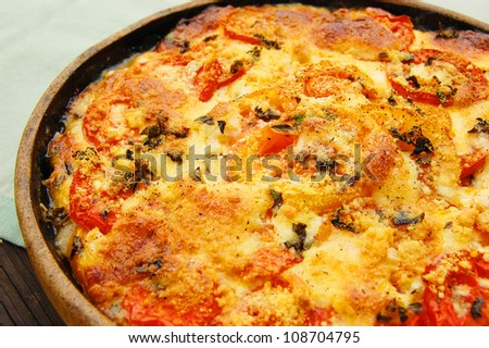 Homemade tomato pie made with red and yellow tomatoes - stock photo