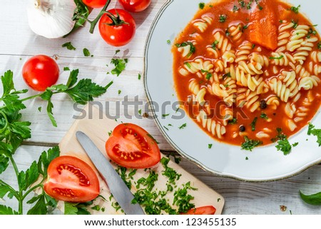 Homemade tomato soup and fresh vegetables