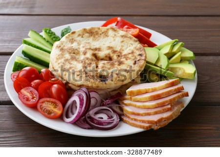 homemade tortillas pita stuffed with vegetables and meat - stock photo