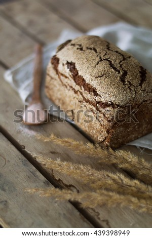 Homemade traditional bread on a wooden table