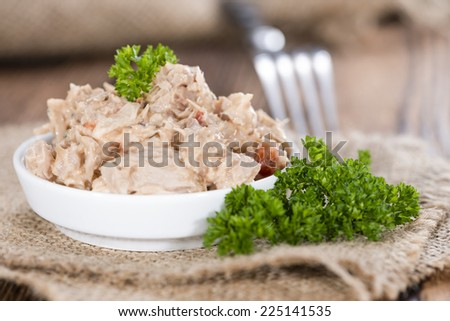 Homemade Tuna Salad in a small bowl (on wooden background) - stock photo