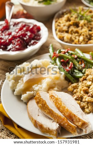 Homemade Turkey Thanksgiving Dinner with Mashed Potatoes, Stuffing, and Corn - stock photo