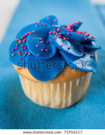 Homemade Vanilla Cupcake with Very Bright Blue Frosting - stock photo