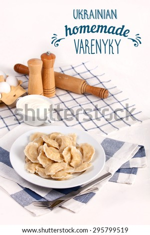Homemade varenyky Ukrainian traditional dish. Perogy, stuffed dumplings served on white plate. Ukrainian cuisine. Background with food, typography and decorations. - stock photo