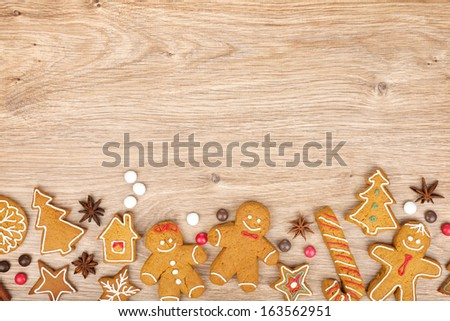 Homemade various christmas gingerbread cookies on wooden background - stock photo