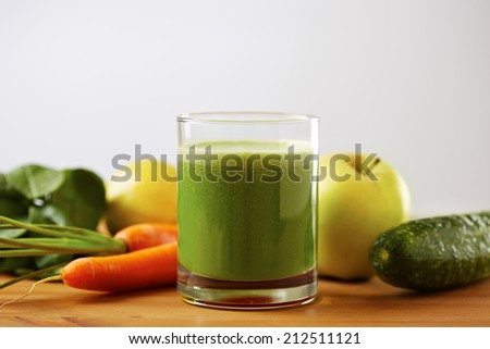 Homemade vegan green juice with fruit and vegetables - stock photo