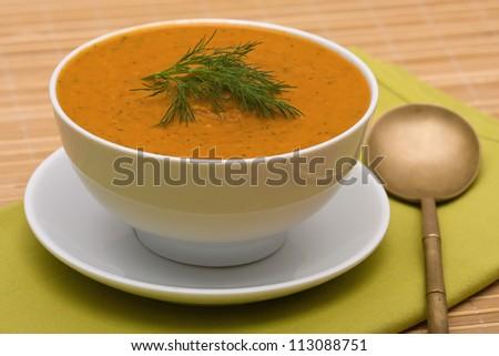 Homemade vegetable cream soup in white bowl - stock photo