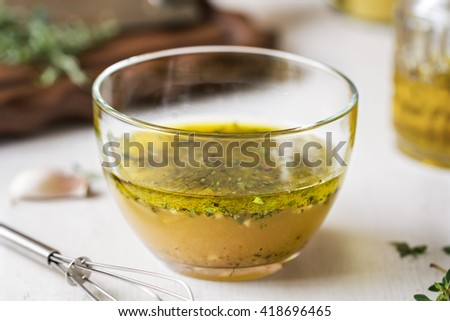 Homemade Vinaigrette with Thyme by fresh ingredients - stock photo