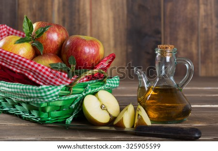 Homemade Vinegar galas apples on a table in a farmhouse - stock photo