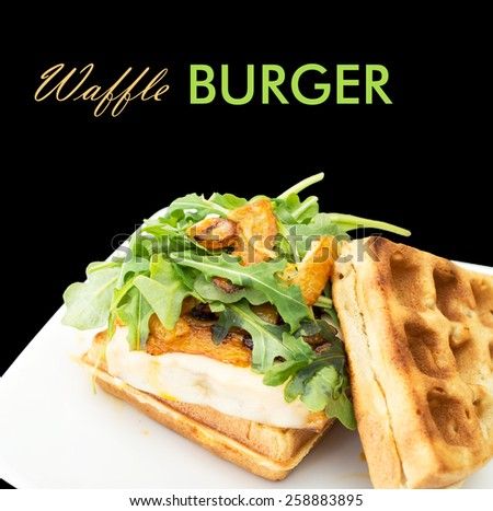 Homemade waffle burger on a white ceramic plate - stock photo