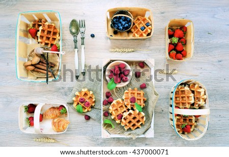 homemade waffles with berries, strawberries, raspberries and blueberries ,Rustic style from above ,flat lay ;Rustic style from above . Food table healthy concept ,,food styling - stock photo