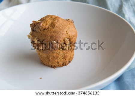 Homemade Walnut Muffins Ready to Eat on white dish