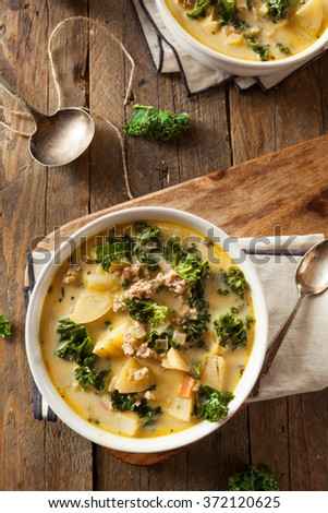 Homemade Warm Creamy Tuscan Soup with Sausage and Kale - stock photo