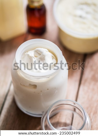Homemade whipped shea butter with natural oils. - stock photo