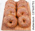 Homemade whole grain bagels with sesame seeds and cranberries.  selective focus, - stock photo
