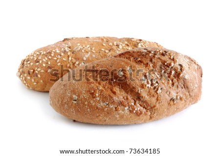 Homemade whole wheat bread on a white background - stock photo