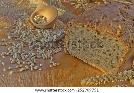 Homemade Whole Wheat Bread on a wooden Background - stock photo