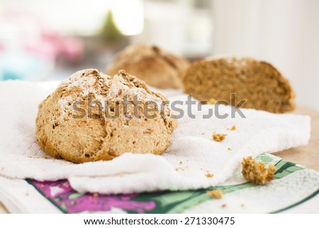 Homemade whole wheat carrot bread over a table, by a window. Horizontal photograph.