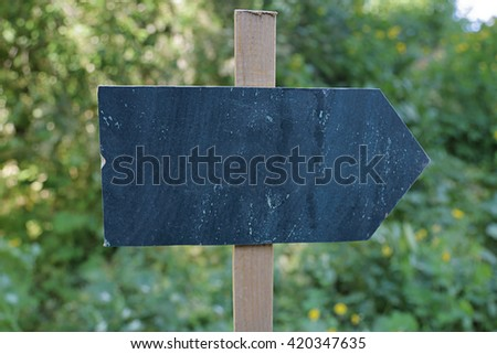 Homemade wooden direction pointer without signs and symbols - stock photo