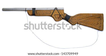 Homemade wooden toy gun isolated on white background - stock photo