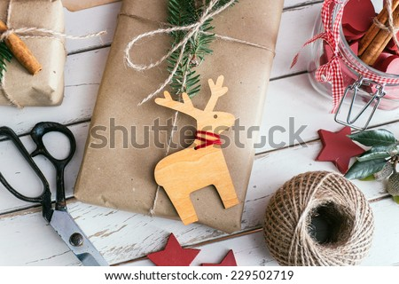 Homemade wrapped christmas presents with tools and decorations