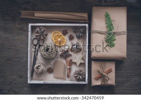 Homemade wrapped christmas presents with tools and decorations - stock photo