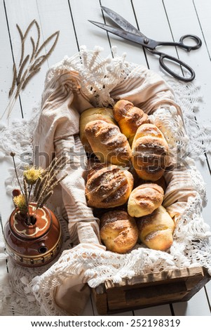 Homemade Yeasted Honey Cornbread Loaves in a Wooden Box and Dried Flowers - stock photo