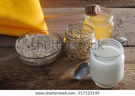 Homemade yogurt with cedar nuts, oatmeal and honey