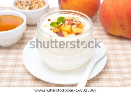 homemade yogurt with honey, peaches and nuts, horizontal - stock photo