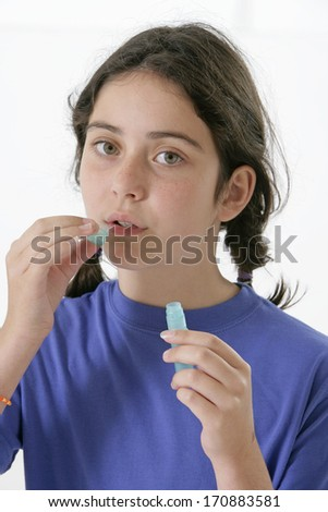 homeopathic medicine - pretty young girl  taking homeopathy  - stock photo