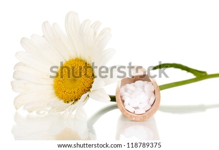 homeopathic tablets and flower isolated on white - stock photo