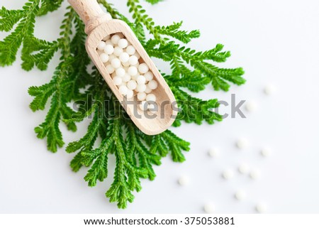 Homeopathy - A homeopathy concept with homeopathic medicine  - stock photo