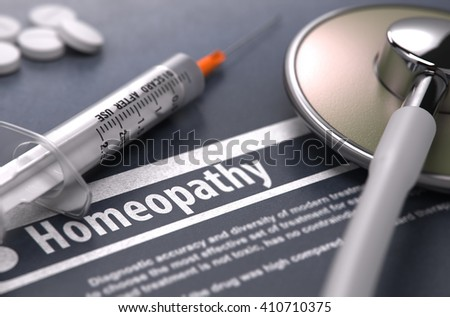 Homeopathy - Medical Concept with Blurred Text, Stethoscope, Pills and Syringe on Grey Background. Selective Focus. 3D Render. - stock photo
