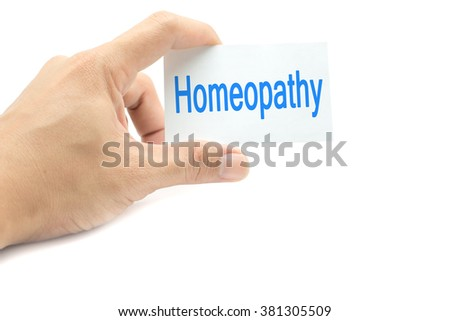 Homeopathy message on the card hand in hand on white background