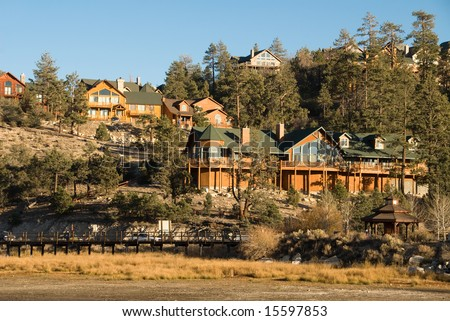 Homes on a hillside of Big Bear Lake mountain resort at sunset.