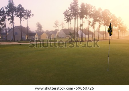 homes on golf course in pre dawn minutes - stock photo