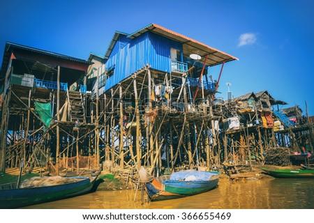 Homes on stilts on the floating village of Kampong Phluk, Tonle Sap lake,Siem Reap province, Cambodia - stock photo