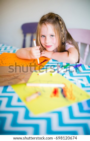 homeschooling girl drawing homework at kitchen table