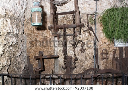 HOMESTEAD, FL - CIRCA APRIL 2010: The hand tools used to build the mysterious Coral Castle circa April, 2010 in Homestead, FL.  The builder took his secrets with him to the grave.