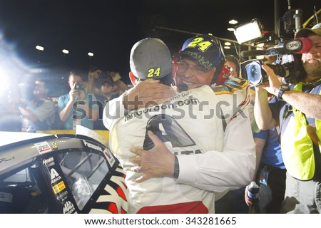 Homestead, FL - Nov 22, 2015:  Jeff Gordon (24) hugs Rick Hendrick after failing to win the 2015 NASCAR Sprint Cup Championship following the FORD 400 at Homestead Miami Speedway in Homestead, FL.  - stock photo