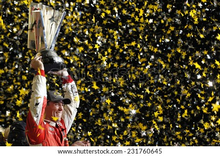 Homestead, FL - Nov 16, 2014:  Kevin Harvick makes a late race move to win the Ford EcoBoost 400 and the Sprint Cup Championship at Homestead Miami Speedway in Homestead, FL.  - stock photo