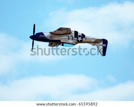 """HOMESTEAD, FL - NOVEMBER 7 : Vintage legendary P51 WWII fighter airplane over Homestead Air Force Base on """"Wings over Homestead"""" Air Demonstration Nov 7, 2010 in Homestead, FL - stock photo"""