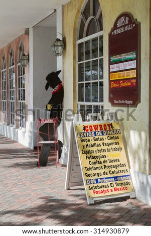 Homestead, FLORIDA - August 04, 2015: Hispanic storefront where people in the local Hispanic community can purchase a variety of goods and services. - stock photo