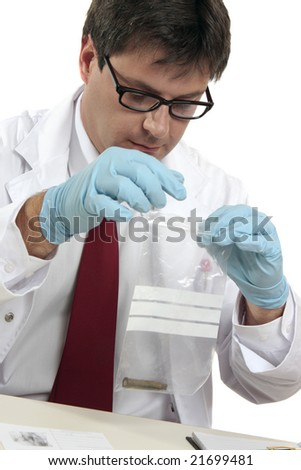 Homicide or murder investigation.   An fbi or csi with a shell casing evidence. - stock photo