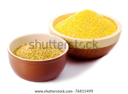 Hominy grits and wheat grits in wooden plates - stock photo