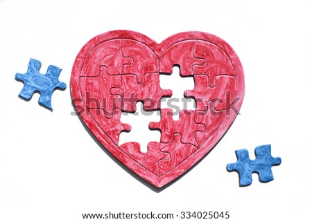 homosexual partner, concept. red heart puzzle with blue details symbolizes love homosexual couples, isolated on white background - stock photo
