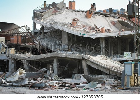 Homs, Syria, September 2013 Destroyed building located near the road between Homs and Damascus. The building destroyed in the fighting between the rebels of the Syrian National Army - stock photo