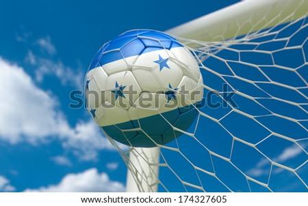 Honduras flag and soccer ball, football in goal net - stock photo