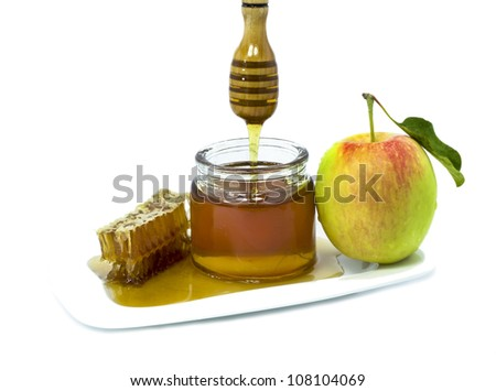 Honey and apple are symbols of Jewish New Year (Rosh hashanah) - stock photo
